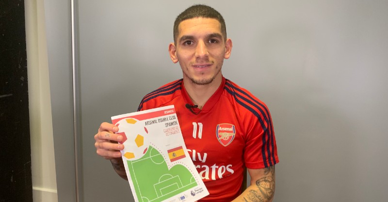 Lucas Torreira with Arsenal Double Club booklets